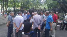 Shenzhen, China: middle-aged and elderly men play chess. In the morning, in Xixiang Park of Shenzhen, the middle-aged and old men played chess as entertainment stock photos