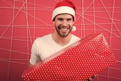The morning before Xmas. man in santa hat hold christmas present. happy man enjoy the holiday. delivery christmas gifts stock images