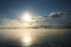 Morning at yellowstone lake. The water is vaporized and looks like they form the cloud in the far end Royalty Free Stock Image