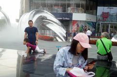 Shenzhen, China: adults and children play around the fountain in the shopping mall Royalty Free Stock Photos