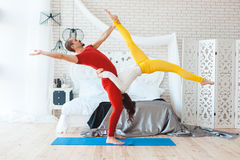 Morning yoga family. Morning yoga gymnastics family, at home in the bedroom after bedtime Royalty Free Stock Images