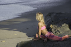 Morning Yoga. Woman doing her yoga at the beach Stock Photography