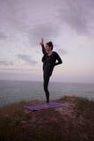 Morning yoga of young woman. stock photos