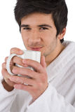 Morning - Young man in bathrobe with cup of coffee Stock Image
