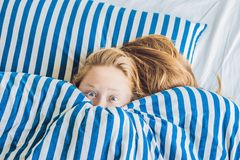 Morning of young pregnant woman suffering from toxicosis at home royalty free stock images