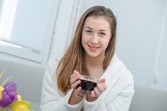 At morning, young and smiling woman drinking coffee Stock Image