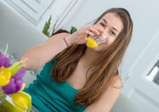 At morning, young and smiling woman drinking orange juice. At morning, a young and smiling woman drinking orange juice Stock Photos