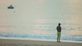 Morning. Young woman taking photograph by cellphone on sea beach stock video footage
