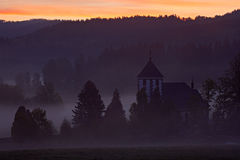 Morning in Zelnava village, Sumava, Czech Republic. Cold day in Sumava National park, hills and villages in the fog and rime, mist Stock Photography