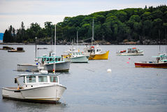 Lobster Boat Harbor. After the mornings catch has been hauled to the market and the traps have all been set the lobster boats await the next trip out to see how royalty free stock photography