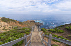 Mornington peninsula attractions at Cape Schanck. Great place to escape in weekends and holidays. Cape schanck boardwalk towards the beach and rocks are one of Stock Image