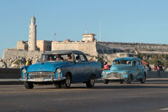 Moro Fortress and Classic old American cars. HAVANA, CUBA, FEBRUARY 16, 2014 : Classic old American car in the streets of Havana. Classic cars are still in use Royalty Free Stock Photography