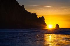 Beautiful sunset over the sea, silhouette of big rocks, Morro Bay, California stock photos