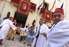 Moro Traidor Parade. Begining of Traitor Moro parade at Jijona´s holidays, Alicante province, Spain, Europe. Arabic is taken from City townhall of Jijona by Stock Photos