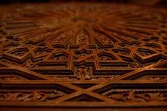 Moroccan arabesque carved wood door. Moroccan arabesque carved wood panel with geometrical pattern on a door in Fes, Morocco Stock Image