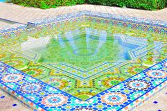Moroccan architecture. A beautiful moor pool decorated with marbles and mozeks, which originated from Morocco and Spain. The pool is constructed at the Pavillion Stock Photo