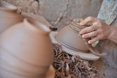 A Moroccan artisan throws a clay pot on a potters wheel. Royalty Free Stock Photography