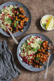Moroccan aubergine and chickpea stew and bulgur. Healthy vegetarian lunch. On a wooden table Stock Image