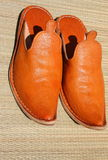 Moroccan babouche. Moroccan oriental genuine orange leather slippers Royalty Free Stock Photography