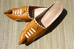 Moroccan babouche. Moroccan oriental genuine tan leather slippers Royalty Free Stock Image