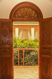 Moroccan balcony entrance with carved wooden doors and fanlight Royalty Free Stock Images