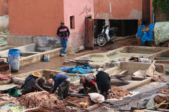 Moroccan Bazzar. Preparing leather - tannery - Marrakech souk - Morocco Stock Images