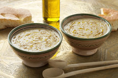Moroccan bessara soup with olive oil and cumin Stock Photography