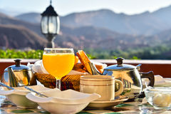 Moroccan breakfast served on hotel terace in Atlas Mountains.  royalty free stock image