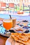 Moroccan breakfast served on hotel terace in Atlas Mountains. Moroccan breakfast served on hotel terrace in Atlas Mountains stock images
