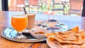 Moroccan breakfast served on hotel terace in Atlas Mountains. Moroccan breakfast served on hotel terrace in Atlas Mountains royalty free stock image