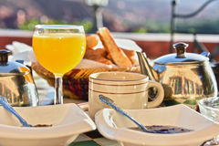 Moroccan breakfast served on hotel terace in Atlas Mountains. Moroccan breakfast served on hotel terrace in Atlas Mountains stock image