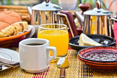 Moroccan breakfast served on hotel terace in Atlas Mountains Royalty Free Stock Image