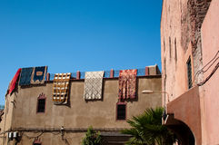 Moroccan building with Berber carpets Royalty Free Stock Photography
