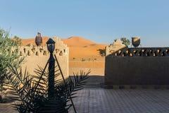 Moroccan building in sahara desert. Garden of moroccan building in sahara desert royalty free stock photos