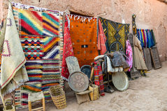 Moroccan carpets and souvenirs. Traditional Moroccan textiles and souvenirs for sale on the street stock image