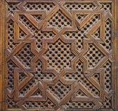 Moroccan Cedar Wood Arabesque Carving. Moroccan carved wood panel on a door in Fes, Morocco Royalty Free Stock Photos