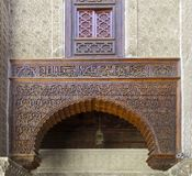 Moroccan Cedar Wood and Carved Plaster Arabesque. Arch in the 14th century  El Attarine Medersa in Fez, Morocco Stock Photos