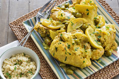 Moroccan chicken served with couscous Stock Images