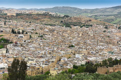 Moroccan City Rooftops - Fez. MWS from hilltop, the old city medina of Fez, ancient capital of Morocco. Big blue sky Stock Photography