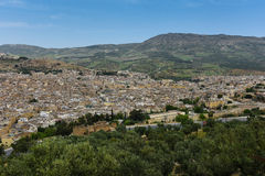 Moroccan City Rooftops - Fez. WS from hilltop, the old city medina of Fez, ancient capital of Morocco. Big blue sky Stock Images