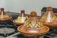 Moroccan clay tajine with different decoration on a stove in a kitchen stock photo