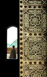 Moroccan copper door and a gatekeeper Stock Image