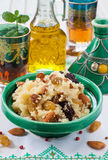 Moroccan couscous with dried fruit and nuts in a tagine Royalty Free Stock Photos