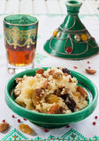 Moroccan couscous with dried fruit and nuts in a tagine Royalty Free Stock Image