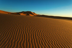 Moroccan desert landscape with blue sky. Dunes background. Stock Image
