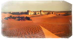 A moroccan desert scenery with an arabian camp of colourful tent Stock Image