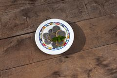 Moroccan dirham in a small assiette on a wodden background.Moroccan money. Argent Stock Image