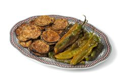 Moroccan dish with baked eggplants and green bell peppers. Isolated on white background Stock Photos