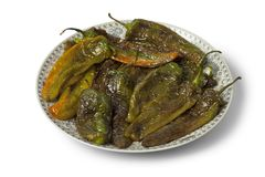 Moroccan dish with deepfried peppers Royalty Free Stock Photos