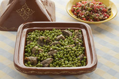 Moroccan dish with meat and green peas Stock Photos
